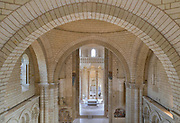Apse, choir with altar and ambulatory, seen from the nave, aerial view, in the Romanesque abbey church of Fontevraud Abbey, Fontevraud-l'Abbaye, Loire Valley, Maine-et-Loire, France. The abbey itself was founded in 1100 by Robert of Arbrissel, who created the Order of Fontevraud. It was a double monastery for monks and nuns, run by an abbess. The abbey is listed as a historic monument and a UNESCO World Heritage Site. Picture by Manuel Cohen