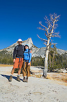 Mid 30s couple at Cathedral Peak in Tuolumne Meadows Yosemite National Park California USA.