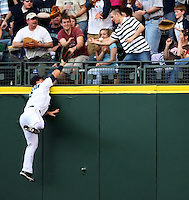Seattle Mariners' right fielder Brad Wilkerson attemps to catch a homerun ball hit by Los Angeles Angels' Casey Kotchman as it hits a fan's arm in the fourth inning of MLB action in Seattle on Saturday, April 12, 2008..(AP Photo/Kevin P. Casey)