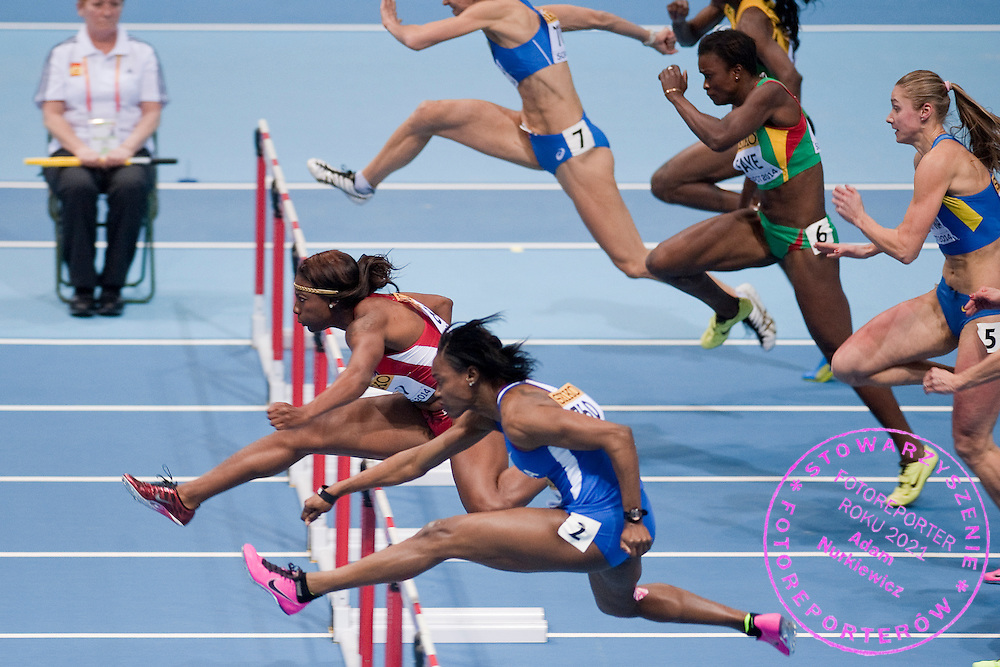 (L) Nia Ali of USA and (C) Yvette Lewis of Panama compete in women's 60 meters hurdles qualification during the IAAF Athletics World Indoor Championships 2014 at Ergo Arena Hall in Sopot, Poland.<br /> <br /> Poland, Sopot, March 7, 2014.<br /> <br /> Picture also available in RAW (NEF) or TIFF format on special request.<br /> <br /> For editorial use only. Any commercial or promotional use requires permission.<br /> <br /> Mandatory credit:<br /> Photo by &copy; Adam Nurkiewicz / Mediasport