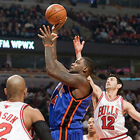 17 December 2009: New York Knicks Eddy Curry takes a jumpshot over Chicago Bulls Kirk Hinrich during the Chicago Bulls 98-89 victory over the New York Knicks at the United Center, in Chicago, Illinois, USA.
