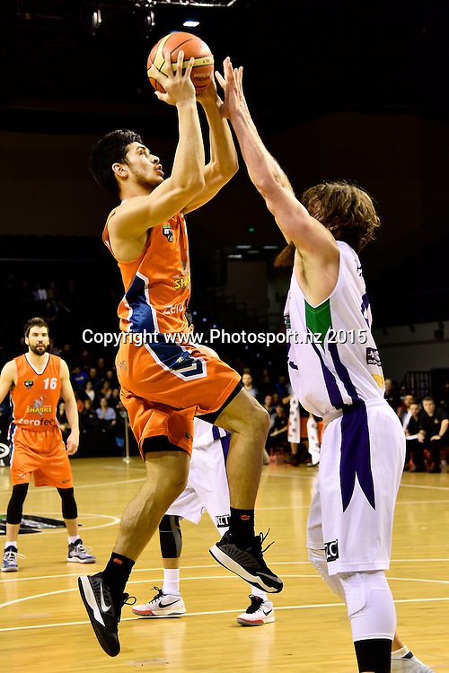 Shea Lli (L) of the Southland Sharks jumps to shoot with Casey Frank of the Super City Rangers during the NBL semi final basketball match between Southland and Super City Rangers at the TSB Arena in Wellington on Saturday the 4th of July 2015. Copyright photo by Marty Melville / www.Photosport.nz