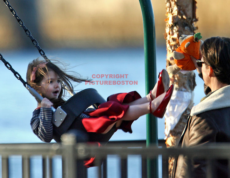 Nov 16, 2009 in Boston,Mass.  Suri and Tom Cruise play along Boston's Charles River.