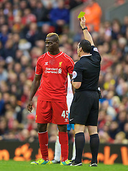 25.10.2014, Anfield, Liverpool, ENG, Premier League, FC Liverpool vs Hull City, 9. Runde, im Bild Liverpool's Mario Balotelli is shown a yellow card against Hull City // 15054000 during the English Premier League 9th round match between Liverpool FC and Hull City at the Anfield in Liverpool, Great Britain on 2014/10/25. EXPA Pictures © 2014, PhotoCredit: EXPA/ Propagandaphoto/ David Rawcliffe<br /> <br /> *****ATTENTION - OUT of ENG, GBR*****