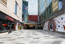© Licensed to London News Pictures. 21/03/2020. Watford, UK.  The INTU Shopping Centre in Watford, north of London is devoid of shoppers at lunchtime today. Coronavirus infections continue to spread throughout London. Photo credit: LNP
