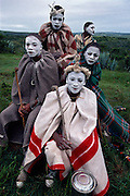 A group of young Xhosa initiates in Ciskei, Eastern Cape Province, South Africa, in December, 2006. Clad in blankets and with their faces painted white to ward off witches, they spend more than a month together living outside their communities. After the initiation period is over, and their circumcision wounds have healed, they return home as real men.