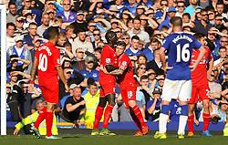Alberto Moreno of Liverpool holds back Mamadou Sakho  - Mandatory byline: Matt McNulty/JMP - 07966 386802 - 04/10/2015 - FOOTBALL - Goodison Park - Liverpool, England - Everton  v Liverpool - Barclays Premier League