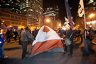 Boston, MA 12/09/2011.Occupy Boston protestors set up a tent in the middle of Atlantic Avenue early Friday morning..Alex Jones / www.alexjonesphoto.com