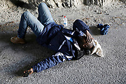 Abdullhai, 38, from Guinea, rests after crossing part of the Alps mountain range from Italy into France, near the town of Nevache in southeastern France