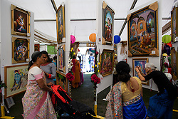 © Licensed to London News Pictures. 02/09/2018. Aldenham, UK. Followers of Hare Krishna look at artwork as part of the Janmashtami Hindu festival at Bhaktivedanta Manor Hare Krishna Temple in Aldenham, Hertfordshire. Janmashtami is an annual Hindu festival that celebrates the birth of Krishna. Bhaktivedanta Manor, the venue fo the event, was donated to the Hare Krishna movement in February 1973 by former Beatle George Harrison. Photo credit: Ben Cawthra/LNP