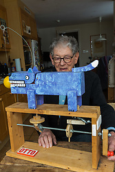Retired product designer turned toy maker, whose many innovations became iconic household names Tom Karen is photographed with toys he created from recycled materials at his home in Cambridge, UK. <br /> PICTURED: Tom with his animatronic dog Otto, which uses a clever 'rolling cam' mechanism to make its operation smoother.<br /> Cambridge, March 01 2018.