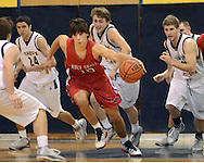 NEW HOPE, PA. - JANUARY 23: Holy Ghost Prep's Joe Braun #10 grabs a loose ball as he is chased by New Hope Solebury defenders in the first quarter at New Hope Solebury High School January 23, 2015 in New Hope, Pennsylvania. (Photo by William Thomas Cain/Cain Images)