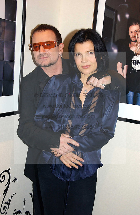 BONO and his wife ALI HEWSON at a party to launch the One T-Shirt by Edun held at Harvey Nichols, Knightsbridge, London on 18th October 2006.<br /><br />NON EXCLUSIVE - WORLD RIGHTS