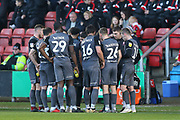 Lincoln players take a drink and some advice from manager  , Danny Cowley during the EFL Sky Bet League 2 match between Crewe Alexandra and Lincoln City at Alexandra Stadium, Crewe, England on 26 December 2018.