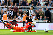 Miguel Almiron (#24) of Newcastle United takes the ball around the diving Ben Foster (#26) of Watford but play is pulled back for an offside decision during the Premier League match between Newcastle United and Watford at St. James's Park, Newcastle, England on 31 August 2019.