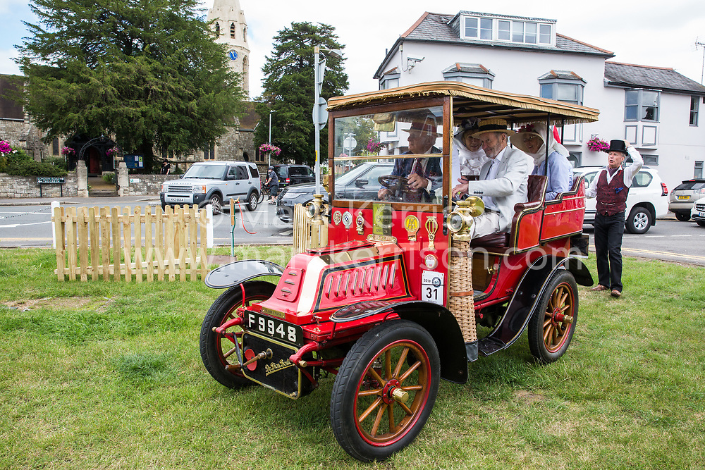 Datchet, UK. 30 June, 2019. A 1904 De Dion Bouton arrives first on the 48-mile Ellis Journey from Micheldever station near Winchester to Datchet, a reenactment of the first recorded journey by a motorised carriage in England undertaken by pioneer automobilist Hon. Evelyn Ellis in his new, custom-built Panhard-Levassor on 5th July 1895.