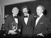 "Texaco Sportstars Of The Year Awards.1983..14.04.1983..04.14.1983..14th April 1983...Photograph of Ronnie Delaney being Congratulated by the Tanaiste,Mr Dick Spring and the Managing Director of Texaco Ireland,Mr Tony Hill,on his induction into the Sportstars ""Hall Of Fame""..Ronnie was a gold medal winner at the 1956 Summer Olympics in Melbourne,Australia. he triumphed in the 1500 metres event..."