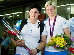 Lucija Polavder and Gold judo medalist Urska Zolnir during reception of Slovenian Olympic team, on August 5, 2012 in Airport Joze Pucnik, Brnik, Slovenia. (Photo by Vid Ponikvar / Sportida.com)