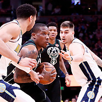 01 April 2018: Milwaukee Bucks guard Eric Bledsoe (6) drives past Denver Nuggets guard Jamal Murray (27) and Denver Nuggets forward Juan Hernangomez (41) during the Denver Nuggets 128-125 victory over the Milwaukee Bucks, at the Pepsi Center, Denver, Colorado, USA.