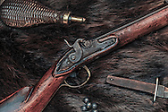 Antique percussion conversion muzzle-loader, with vintage accessories.