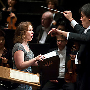 """November 21, 2013 - New York, NY :  Conductor Alan Gilbert, right, leads the New York Philharmonic and Mezzo-soprano Sasha Cooke, left, in Bejamin Britten's """"Spring Symphony, Op. 44 (1948-49)"""" with the New York Philharmonic at Avery Fisher Hall at Lincoln Center on Thursday night. CREDIT: Karsten Moran for The New York Times"""