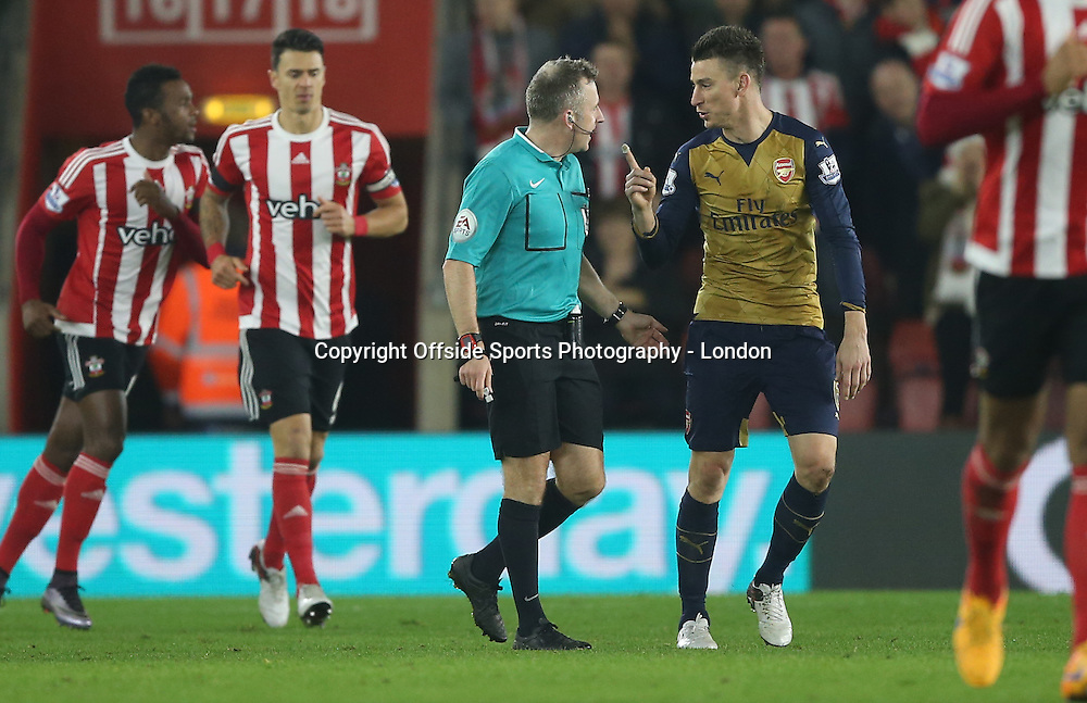 26 Devember 2015 - Premier League Football - Southampton v Arsenal :<br /> Arsenal defender Laurent Koscielny complains to referee Moss about the second Southampton goal.<br /> Photo: Mark Leech