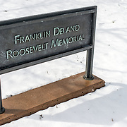 A sign for the FDR Memorial on the banks of the Tidal Basin after a recent snowfall.