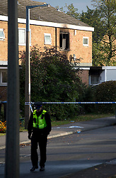 ©  London News Pictures. 15/10/2012. Harlow, UK. Police at the scene on Barn Mead, Harlow, Essex where three children and a woman have died and three others are in hospital following a house fire. Two boys aged 13 and six, a girl aged 11 and the woman were declared dead at the scene. A nine-year-old boy and a three-year-old girl have serious burns and a man has minor burns. Photo credit : Ben Cawthra/LNP