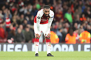 Arsenal striker Alexandre Lacazette (9) with hands on knees after final whistle during the Europa League semi final first leg match between Arsenal and Atletico Madrid at the Emirates Stadium, London, England on 26 April 2018. Picture by Matthew Redman.