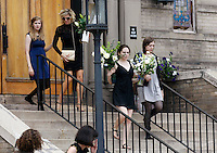 The three daughters of Gordon Cowden and his ex-wife (2nd L) carry out the flowers from his memorial service at Pathways church in Denver July 25, 2012.  Cowden along with 11 others was killed in a shooting at a movie theater in Aurora, Colorado last Friday. The daughters are Kristian, Brooke and Cierra.  REUTERS/Rick Wilking (UNITED STATES)