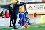 Mansfield Town Manager David Flitcroft has words with Mansfield Town midfielder Will Atkinson (11) as he comes off the bench during the EFL Sky Bet League 2 match between Mansfield Town and Northampton Town at the One Call Stadium, Mansfield, England on 29 September 2018.