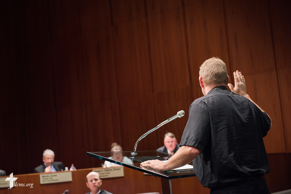 The Rev. Peter M. Burfeind, new domestic missionary and campus pastor at the University of Toledo, is sworn in before speaking at a Toledo-Lucas County Plan Commission meeting on Thursday, July 9, 2015, in Toledo, Ohio. LCMS Communications/Erik M. Lunsford