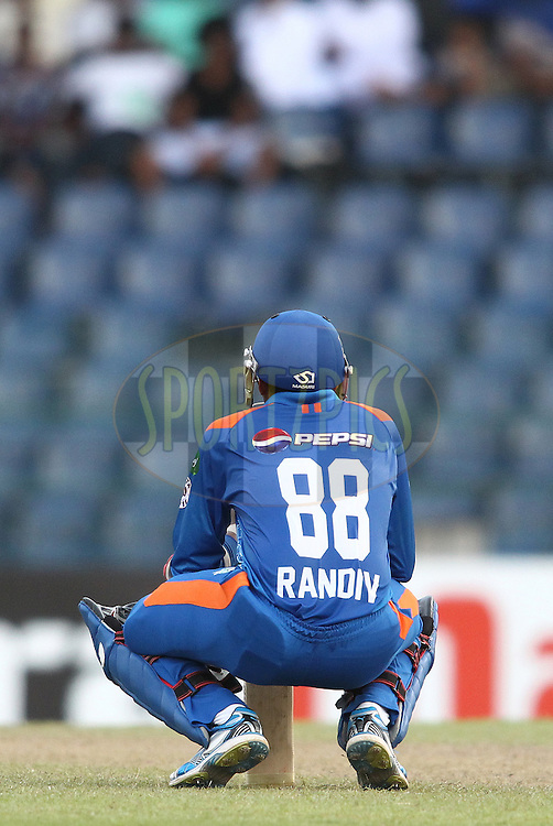 Suraj Randiv of Nagenahira Nagas takes a breather between overs during match 19 of the Sri Lankan Premier League between Uthura Rudras and Nagenahiras held at the Premadasa Stadium in Colombo, Sri Lanka on the 26th August 2012. .Photo by Shaun Roy/SPORTZPICS/SLPL