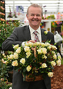 "© Licensed to London News Pictures. 20/05/2013. London, UK Ian Hislop holds up a basket of the ""Pride and Prejudice Rose"". Press day at Chelsea Flower Show 2013. The centenary edition of the show attracts large number of visitors and is already sold out before opening day. Photo credit : Stephen Simpson/LNP"