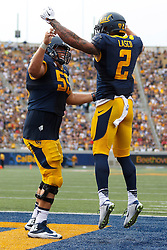 BERKELEY, CA - SEPTEMBER 12:  Running back Daniel Lasco #2 of the California Golden Bears is congratulated by offensive lineman Dominic Granado #55 of the California Golden Bears after scoring a touchdown against the San Diego State Aztecs during the third quarter at California Memorial Stadium on September 12, 2015 in Berkeley, California. The California Golden Bears defeated the San Diego State Aztecs 35-7. (Photo by Jason O. Watson/Getty Images) *** Local Caption *** Daniel Lasco; Dominic Granado