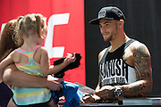 LAS VEGAS, NV - JULY 9:  Dustin Porier signs an autograph for fans during the UFC Fan Expo at the Las Vegas Convention Center on July 9, 2016 in Las Vegas, Nevada. (Photo by Cooper Neill/Zuffa LLC/Zuffa LLC via Getty Images) *** Local Caption *** Dustin Porier