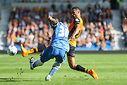 Brighton midfielder, winger, Kazenga LuaLua clears the ball with Hull City midfielder Ahmed Elmohamady tackling during the Sky Bet Championship match between Brighton and Hove Albion and Hull City at the American Express Community Stadium, Brighton and Hove, England on 12 September 2015. Photo by Phil Duncan.