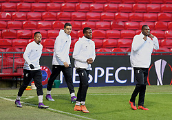 MANCHESTER, ENGLAND - Wednesday, March 16, 2016: Liverpool's Nathaniel Clyne, Tiago Ilori, Divock Origi and Christian Benteke during a training session at Old Trafford ahead of the UEFA Europa League Round of 16 2nd Leg match against Manchester United. (Pic by David Rawcliffe/Propaganda)