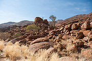 Rocky arid desert landscape. Photographed in Hoanib river gorge, Namibia