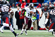 LITTLE ROCK, ARKANSAS - NOVEMBER 23:  Damian Williams #14 of the Mississippi State Bulldogs runs the ball against the Arkansas Razorbacks at War Memorial Stadium on November 23, 2013 in Little Rock, Arkansas.  (Photo by Wesley Hitt/Getty Images) *** Local Caption *** Damian Williams