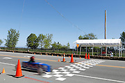 A competitor crosses the finish line at a local soapbox derby race on Lakeshore Boulevard in Irondequoit on Saturday, May 31, 2014. Eighty-two competitors raced in six divisions, with the winner of each division advancing to the world championships in Akron, Ohio.