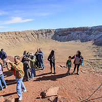 123113       Cable Hoover<br /> <br /> Visitors stop to take pictures and look over the rim of the crater Tuesday at Meteor Crater.