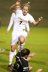 Virginia Cavaliers F/M Caitlin Miskel (7) leaps over a Maryland slide tackle.  The #3 ranked Virginia Cavaliers Women's Soccer team faced the Maryland Terrapins at Klockner Stadium in Charlottesville, VA on October 25, 2007.