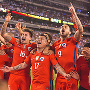EAST RUTHERFORD, NEW JERSEY - JUNE 26:  Nicolas Castillo #16 of Chile, Gary Medel #17 of Chile and Mauricio Pinilla #9 of Chile and other team members celebrate victory during the Argentina Vs Chile Final match of the Copa America Centenario USA 2016 Tournament at MetLife Stadium on June 26, 2016 in East Rutherford, New Jersey. (Photo by Tim Clayton/Corbis via Getty Images)