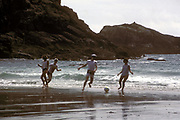 Playing football on the beach, Pembrokeshire, UK, 1987