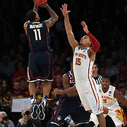 Ryan Boatright, Connecticut, shoots a three past Naz Long, Iowa, during the Iowa State Cyclones Vs Connecticut Huskies basketball game during the 2014 NCAA Division 1 Men's Basketball Championship, East Regional at Madison Square Garden, New York, USA. 28th March 2014. Photo Tim Clayton