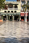 Pedestrians walk along the Plaza de las Armas and the Portales de Veracruz in the historic center of the city of Veracruz, Mexico. The area is the main public square in Veracruz.