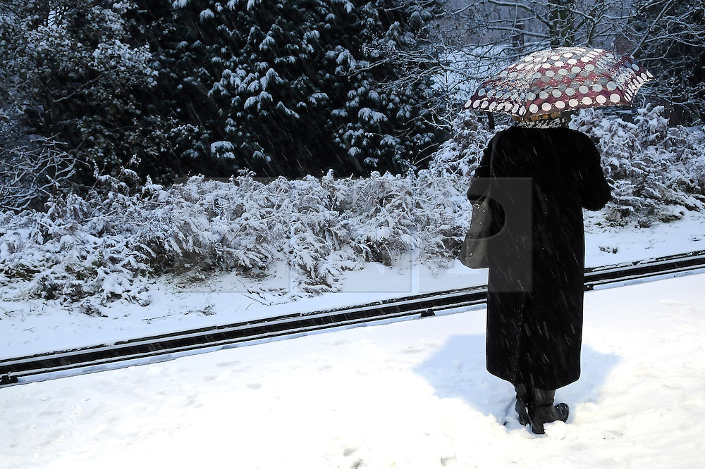 © under license to London News Pictures. 30.11.2010  Early morning commuters (7.30) at St Mary Cray, train station in Orpington, Kent today, brave the snow and the cold to get  a train to London. All trains showing delayed.. Picture credit should read Grant Falvey/London News Pictures