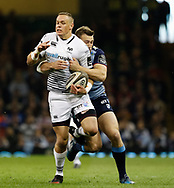 Ospreys' Hanno Dirksen is tackled by Cardiff Blues' Garyn Smith<br /> <br /> Photographer Simon King/Replay Images<br /> <br /> Guinness PRO14 Round 21 - Cardiff Blues v Ospreys - Saturday 28th April 2018 - Principality Stadium - Cardiff<br /> <br /> World Copyright &copy; Replay Images . All rights reserved. info@replayimages.co.uk - http://replayimages.co.uk