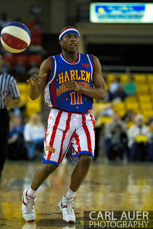 05 May 2006: Keiron 'Sweet P' Shine passes the ball up court in the Harlem Globetrotters basketball game vs the New York Nationals at the Sulivan Arena in Anchorage Alaska during their 80th Anniversary World Tour.